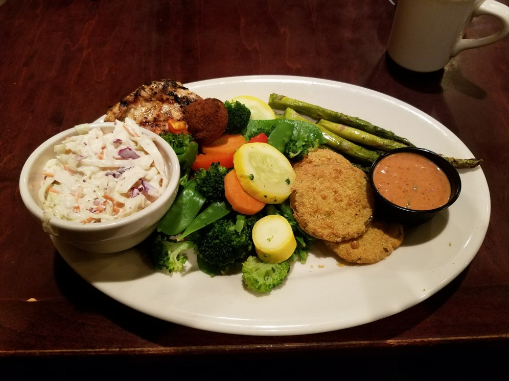 Zach's plate at Crescent City Grill with steamed veggies, fried green tomatoes, coleslaw, and asparagus.